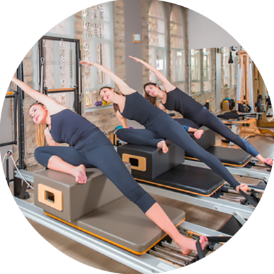 Pilates One Studio Trio Pilates class students on reformers